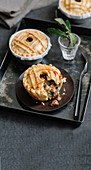 Small lamb and herb pies