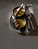 Potato and leek cream soup with salsiccia and sage kebabs