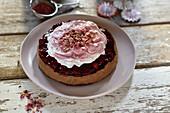 Vegan nougat cheesecake with raspberries and cream