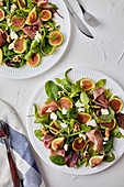 Salad with fresh figs, prosciutto, goat cheese and walnuts