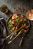 Minted lamb mince kebabs with giant couscous salad