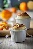 Orange soufflé with Cointreau-Maraschino infused fruit salad