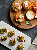 Brunch canapés with salmon, avodcado and bacon