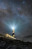 Milky Way over a lighthouse