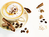 Cappuccino with chocolate and coffee beans