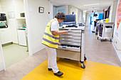 Nurse dispensing drugs on hospital ward