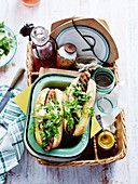 Sausages and herb salad rolls