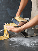 How to make your own pasta: turn pasta dough through a pasta machine