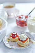 Scones with chantilly cream and strawberry jam