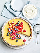 Lemon tart with berries and powdered sugar