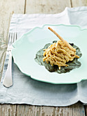 Spelt pasta with whitefish cream on sepia sauce