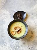 Cream of celeriac soup with black truffles