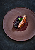 Seared duck breast with a red cabbage roulade and ginger