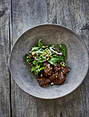Fried ox heart with a parsley and caper salad