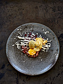 Beef tartare with beetroot, horseradish and potato crisps