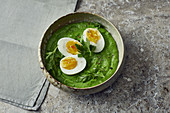 Boiled eggs with green purée