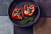Stuffed pepper with black beans, tofu and cheese