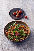 Carrot noodle bowl with almond pesto