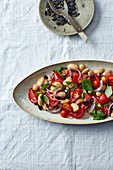 Vegan tomato salad with white beans and pumpkin seeds