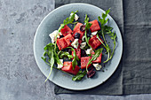 Watermelon salad with feta cheese, olives and rocket