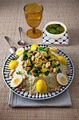 Couscous with saffron eggs and almonds, Morocco