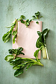 Spinach and chard on a pink table cloth