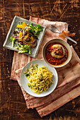 Three onion dishes: orange and onion salad, stuffed onion & tagliolini with onion and lemon