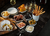 Mediterranean blackboard with tapas on dark wooden table (Spain)