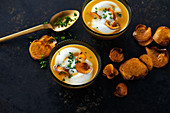 Wintry sweet potato soup with milk foam and parsley