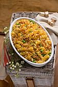 Fusilli bake with leek, peas, almonds and crispy crumbs