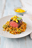 Fillet steak with balsamic lentils and mango tartare