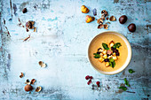 Cream soup with chestnuts and cranberry pesto