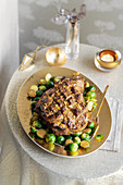 Leg of saffron and nut lamb with Brussels sprouts