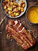 A whole saddle of wild boar with fried potatoes and apricot purée