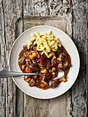 Venison goulash with Swabian egg noodles and lingon berries