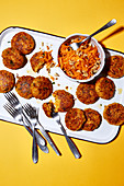 Bulgur and vegetable fritters with a carrot salad