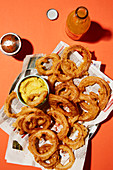 Beer-battered onion rings with a curry dip