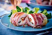 Chicken ballotine with bacon, mozzarella and dried tomatoes