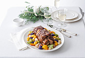 Roast beef with dark beer and honey on a colourful cauliflower medley