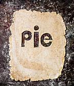 Das Wort 'Pie' ausgestochen aus Teigplatte