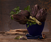 Artichokes and parsley in a blue vase