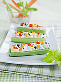 Celery boats with cream cheese and vegetables