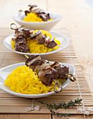 Lamb skewers on saffron rice