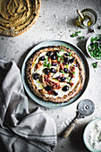 Sweet potato pizza with olives, ricotta and prosciutto