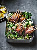Roast lamb rack, lentils, spinach, lemon and feta