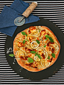 Pizza with smoked cheese, lemon and basil