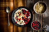 Porridge almond butter and whiskey candied pumpkin seeds berries