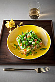 Russian salad with salmon, asparagus and fava beans