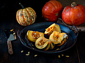 Pumpkins and squashes with squash cut open
