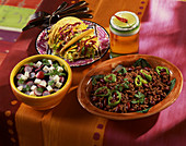 Chilli con carne, tacos and a feta cheese and radish salad (Mexico)
